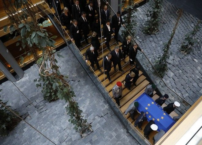 Officials follow the coffin of former German Chancellor Helmut Kohl after a ceremony at the European Parliament in Strasbourg, eastern France, Saturday July 1, 2017. Current and former world leaders gathered Saturday to bid farewell to Kohl, recalling him as a man who was instrumental in uniting Europe and bringing about reconciliation between former adversaries on the continent. (AP Photo/Jean-Francois Badias)