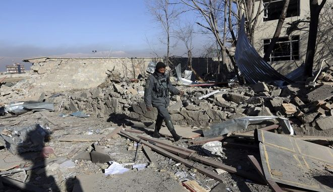 An Afghan security forces walks the aftermath of Wednesday's suicide attack and shooting in district police headquarters in Kabul, Afghanistan, Thursday, March 2, 2017.  Near-simultaneous Taliban suicide bombings and an hours-long shootout with Afghan security forces left at least more than a dozen of people dead and over 100 wounded in Kabul on Wednesday a stark reminder of the militants' ability to stage large-scale and complex attacks in the country's capital. (AP Photo/Rahmat Gul)