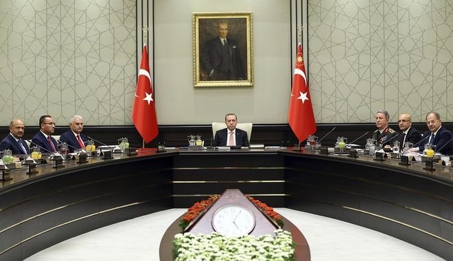 Turkey's President Recep Tayyip Erdogan, center chairs the National Security Council in Ankara, Turkey, Friday, Sept. 22, 2017. Turkey's political and military leaders met to consider possible sanctions and other measures against Iraq's Kurdish region if it goes ahead with a referendum for independence. The Council met followed by a Cabinet meeting on Friday as the country stepped up pressure on Iraq's Kurds to abandon the vote slated for Sept. 25. (Presidential Press Service, pool photo via AP)