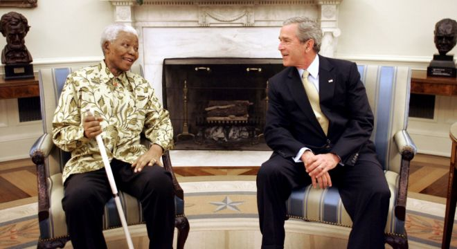 U.S. President George W. Bush meets with former South African President Nelson Mandela in the Oval Office of the White House, May 17, 2005. Mandela yesterday said that he backs Bush's call for global