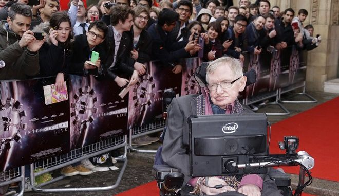 Professor Stephen Hawking poses for photographers upon arrival for the Interstellar Live show at the Royal Albert Hall in central London, Monday, 30 March, 2015. Christopher Nolans film will be shown on the big screen, whilst composer Hans Zimmer leads a 60-piece orchestra and the Halls Grand Organ in a simultaneous performance of the movies Academy and BAFTA nominated score. (Photo by Joel Ryan/Invision/AP)