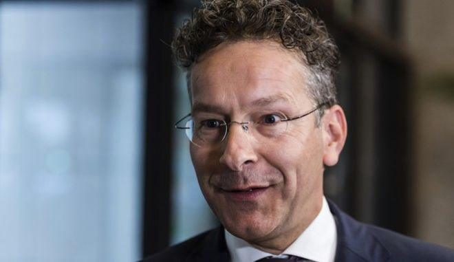 Dutch Finance Minister and chair of the Eurogroup Jeroen Dijsselbloem talks with journalists prior to a meeting of Eurogroup finance ministers at the EU Council building in Brussels, Monday July 10, 2017. (AP Photo/Geert Vanden Wijngaert)