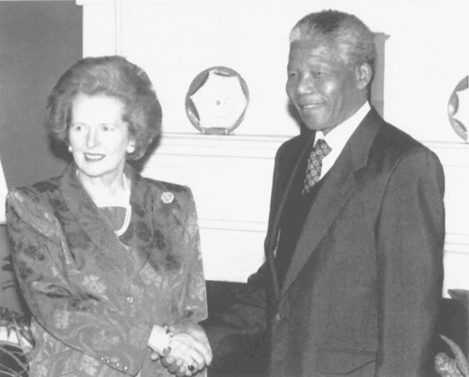 British Prime Minister Margaret Thatcher shakes hands with ANC deputy leader Nelson Mandela inside 10 Downing Street, London, on July 4, 1990, prior to talks and a luncheon. Mandela is on a three-day visit to Britain as part of an extensive international tour. (AP Photo/Cleaver)