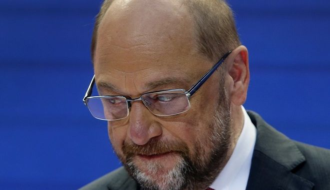 Social Democrat party Leader Martin Schulz looks down as he speaks during a board meeting at the SPD headquarters in Berlin, Germany, Monday, Sept. 25, 2017, the day after parliament election. (AP Photo/Michael Probst)