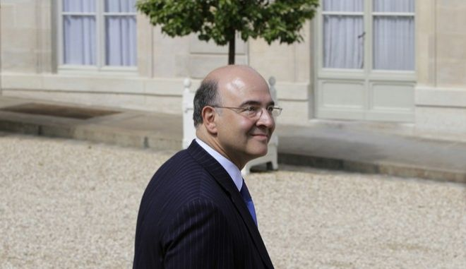 France's Finance Minister Pierre Moscovici walks out the Elysee Palace after the weekly cabinet meeting in Paris, Wednesday, June 13, 2012. (AP Photo/Francois Mori) -