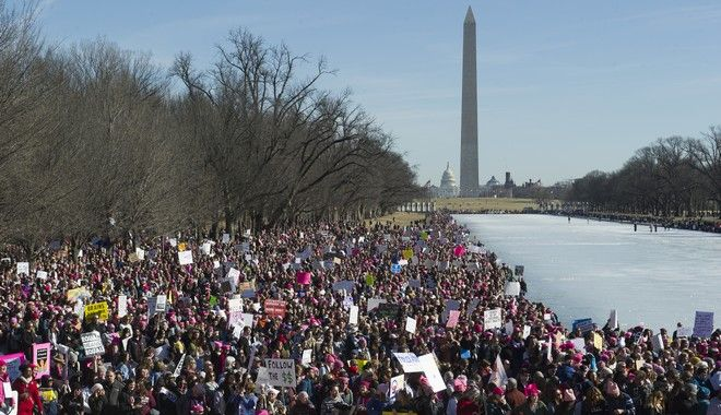 Participants in the Women's March gather near the Lincoln Memorial in Washington, Saturday, Jan. 20, 2018. On the anniversary of President Donald Trumps inauguration, people participating in rallies and marches in the U.S. and around the world Saturday denounced his views on immigration, abortion, LGBT rights, women's rights and more. (AP Photo/Cliff Owen)