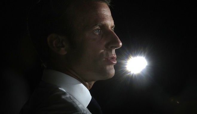 France's President Emmanuel Macron delivers a speech during a press conference during his visit in the French Caribbean islands of St. Martin, Tuesday, Sept. 12, 2017. Macron is in the French-Dutch island of St. Martin, where 10 people were killed on the French side and four on the Dutch after the passage of Hurricane Irma. (AP Photo/Christophe Ena, Pool)