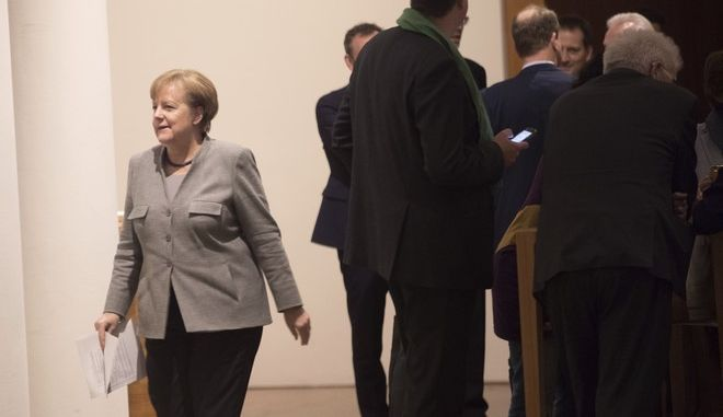 German chancellor Angela Merkel is on her way to another round of exploratory talks of her Christian parties' bloc , the Free Democrats and the Green Party, in Berlin, Sunday, Nov. 19, 2017. They are seeking compromises on the thorny issues of migration and climate change so they can proceed with formal talks on forming a new coalition government. ( Joerg Carstensen/dpa via AP)