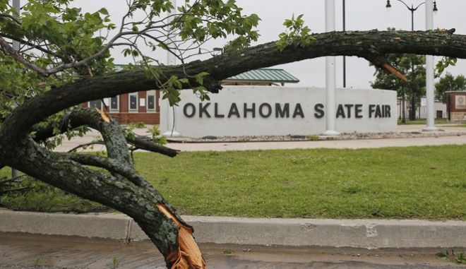 A fallen tree is pictured at the Oklahoma State Fair Park in Oklahoma City, Saturday, April 29, 2017. Severe thunderstorms have toppled tree limbs and power lines and caused minor flooding across Oklahoma. (AP Photo/Sue Ogrocki)