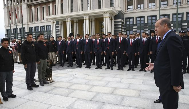Turkey's President Recep Tayyip Erdogan inspects security force members who are guarding his palace, in Ankara Turkey, Monday, April 10, 2017. Turkey is heading to a contentious April 16 referendum on constitutional reforms to expand Erdogan's powers.(Kayhan Ozer/Presidential Press Service, Pool Photo via AP)