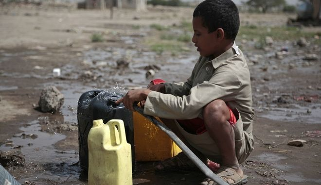 A boy fills a container with water from a well that is allegedly contaminated with cholera bacteria, on the outskirts of Sanaa, Yemen, Wednesday, July 12, 2017. The U.N. health agency said Tuesday that plans to ship cholera vaccine to Yemen are likely to be shelved over security, access and logistical challenges in the war-torn country. Yemen's suspected cholera caseload has surged past 313,000, causing over 1,700 deaths in the world's largest outbreak. (AP Photo/Hani Mohammed)