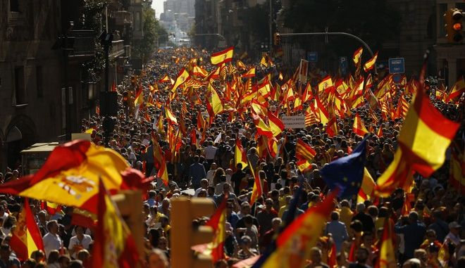 2017 AP YEAR END PHOTOS - Thousands of people march to protest the Catalan government's push for secession from the rest of Spain in Barcelona on Oct. 8, 2017. (AP Photo/Francisco Seco)