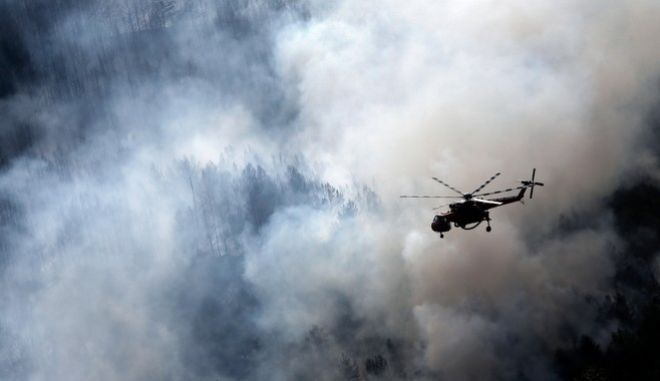 Wildfire near the village of Rachoni in the island of Thassos, Greece on September 11, 2016. /         , 11  2016.