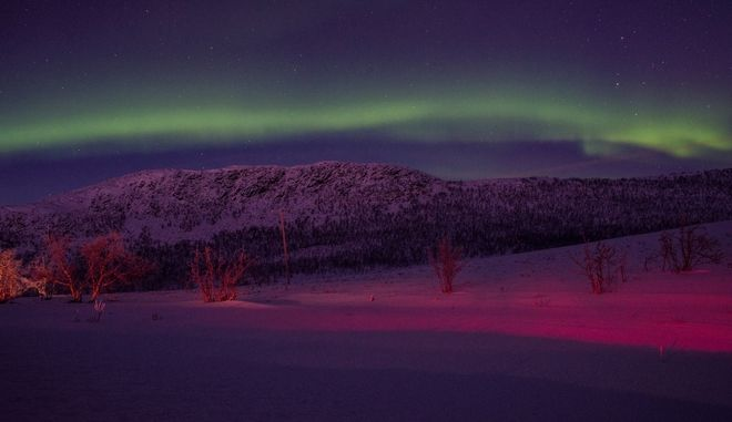 A 3500km winter roadtrip to the Arctic Circle. The Aurora Borealis shines above the E8 National road, also known as the Northern Lights Route, close to the Norway-Finland borders, in Norway, on January 2, 2017  /   3500.   .          8,       ,   -,  ,  2  , 2017