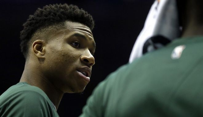 Milwaukee Bucks' Giannis Antetokounmpo talks to a teammate during a timeout during a preseason NBA basketball game against the Indiana Pacers Wednesday, Oct. 4, 2017, in Milwaukee. (AP Photo/Aaron Gash)