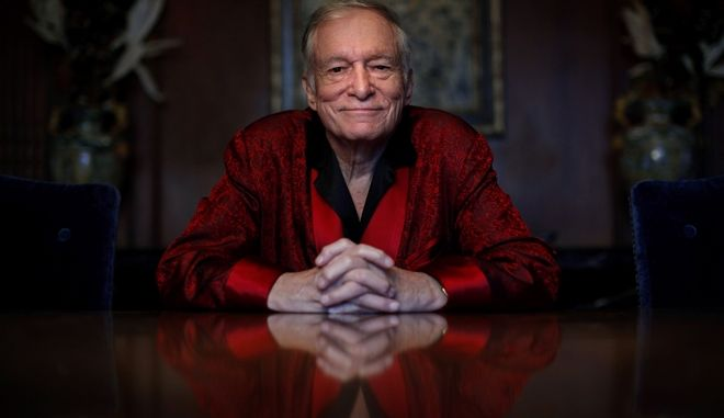 FILE - In this Nov. 4, 2010, file photo, Playboy magazine founder Hugh Hefner poses for photos at the Playboy Mansion in Los Angeles. The Playboy magazine founder and sexual revolution symbol Hefner has died at age 91. The magazine released a statement saying Hefner died at his home of natural causes on Wednesday night, Sept. 27, 2017, surrounded by family. (AP Photo/Jae C. Hong, File)
