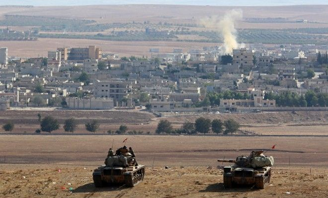 SANLIURFA, TURKEY - OCTOBER 8:   Tanks of Turkish Armed Forces are seen on the hills at the Turkey - Syria borderline in the Suruc district of Sanliurfa Turkey, as the clashes between the Islamic State of Iraq and the Levant (ISIL) and Kurdish armed groups continue in Ayn al-Arab city (Kobani) on October 8, 2014. (Photo by Emin Menguarslan/Anadolu Agency/Getty Images)
