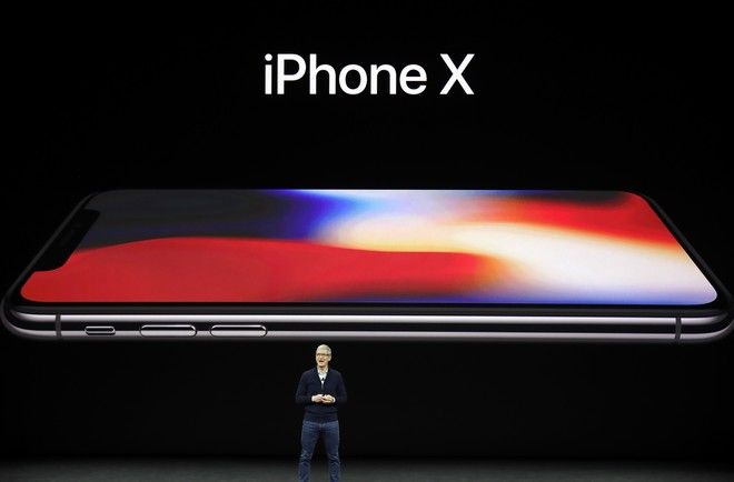 Apple CEO Tim Cook announces the new iPhone X at the Steve Jobs Theater on the new Apple campus, Tuesday, Sept. 12, 2017, in Cupertino, Calif. (AP Photo/Marcio Jose Sanchez)