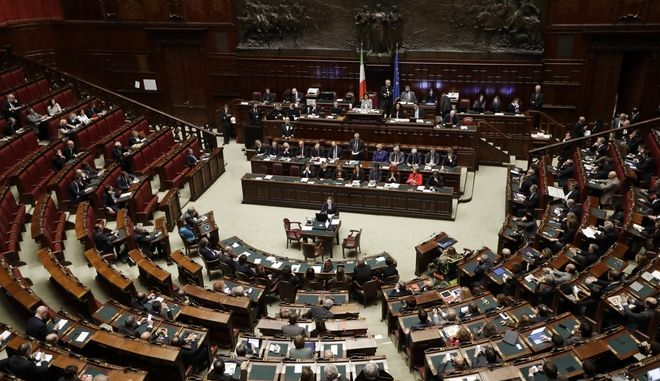 A view of the Italian parliament as Italian Prime Minister Paolo Gentiloni gives his first speech as premier at the lower house where he will later face a confidence vote, in Rome Tuesday, Dec. 13, 2016. Paolo Gentiloni, a Democrat formerly serving as foreign minister, formed Italys new government Monday, keeping several key ministers from the coalition of Matteo Renzi, who resigned last week. (AP Photo/Alessandra Tarantino)