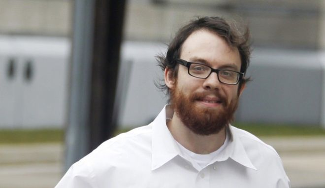 FILE - In this Feb. 28, 2011, file photo, Andrew Auernheimer leaves the Martin Luther King, Jr. Courthouse in Newark, N.J. Auernheimer, a notorious computer hacker and internet troll associated with The Daily Stormer, told The Associated Press on Friday, May 12, 2017, that a Spanish-language edition of the website launched less than a month ago. (AP Photo/Julio Cortez, File)