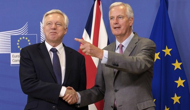 EU chief Brexit negotiator Michel Barnier, right, welcomes British Secretary of State David Davis for a meeting at the EU headquarters in Brussels, Monday July 17, 2017. (AP Photo/Geert Vanden Wijngaert)