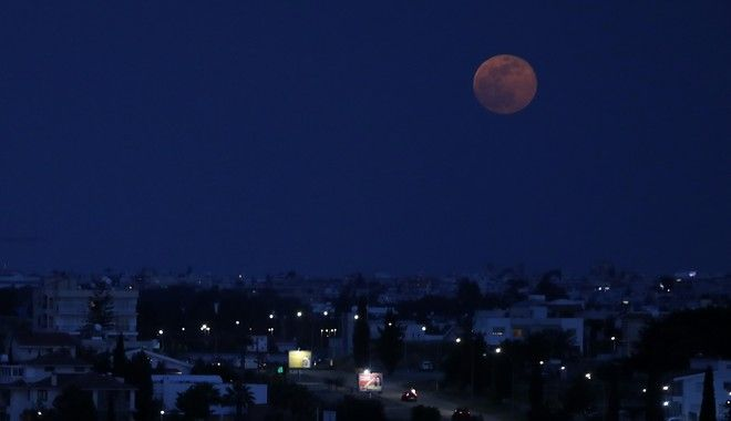 A full moon rises over the capital Nicosia, Cyprus, on Thursday, May 7, 2020. (AP Photo/Petros Karadjias)