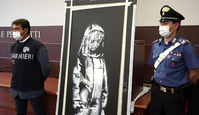Οι Ιταλικές αρχές με το έργο του Banksy