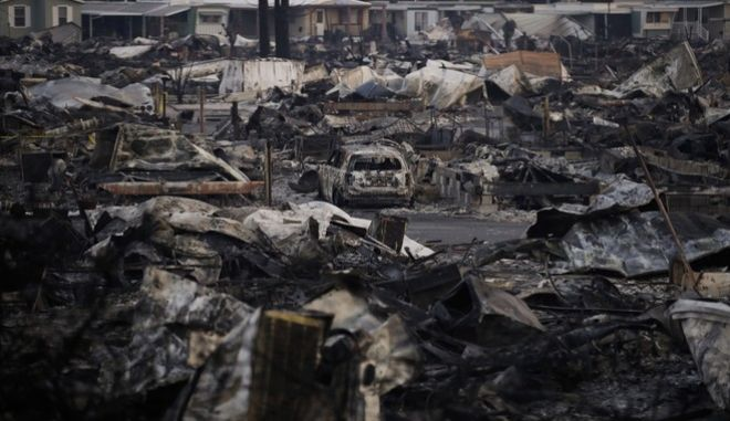 A mobile home park devastated by a wildfire is seen Friday, Oct. 13, 2017, in Santa Rosa, Calif. A fifth day of desperate firefighting in California wine country brought a glimmer of hope Friday as crews battling the flames reported their first progress toward containing the massive blazes, and hundreds more firefighters poured in to join the effort. (AP Photo/Jae C. Hong)