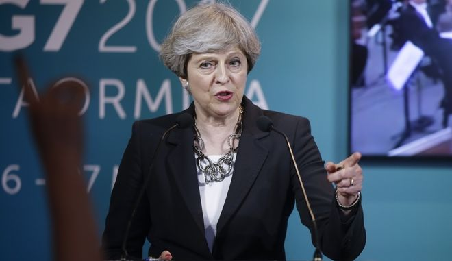 FILE - In this Friday May 26, 2017 file photo, British Prime Minister Theresa May speaks during a news conference in the Sicilian town of Taormina, Italy. Until a week ago, two things were widely agreed about Britain's election: it was the dullest campaign in recent memory, and the result was a foregone conclusion. It would be a coronation march for Conservative Prime Minister Theresa May. Then a bomb blast killed more than 20 people at a concert in Manchester, bringing the campaign to a shocked halt. When it resumed three days later, it was to a jittery nation and a transformed political landscape. (AP Photo/Luca Bruno, file)