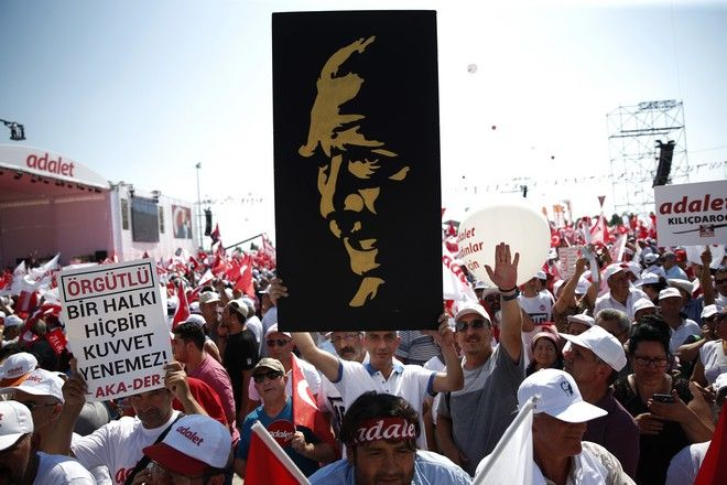 Supporters of Kemal Kilicdaroglu, the leader of Turkey's main opposition Republican People's Party, shout slogans as they gather for a rally following their 425-kilometer (265-mile) 'March for Justice' in Istanbul, Sunday, July 9, 2017. The leader of the main opposition party in Turkey is set to complete the final stretch of a 25-day