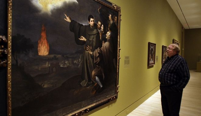 "Pat McKenzie of Indiaanpolis examines the oil on canvas painting by Bartolome Esteban Murillo on display in the exhibit ""Sacred Spain"" at the Indianapolis Museum of Art in Indianapolis, Tuesday, Nov. 17, 2009. (AP Photo/Darron Cummings)"