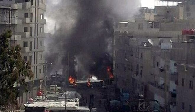 In this photo released by the Syrian official news agency SANA, smoke rises after three bombs exploded in Sayyda Zeinab, a predominantly Shiite Muslim suburb of the Syrian capital, Syria, Sunday, Jan. 31, 2016. The triple bombing claimed by the extremist Islamic State group killed at least 45 people near the Syrian capital of Damascus on Sunday, overshadowing an already shaky start to what are meant to be indirect Syria peace talks. (SANA via AP)
