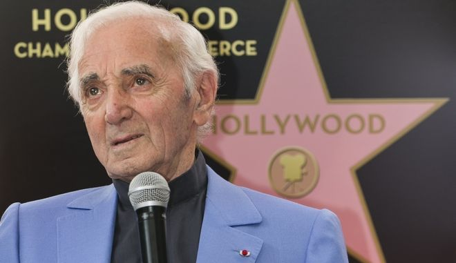 Singer and songwriter Charles Aznavour appears at a ceremony honoring him with a star on the Hollywood Walk of Fame in Los Angeles Thursday, Aug. 24, 2017. (AP Photo/Damian Dovarganes)