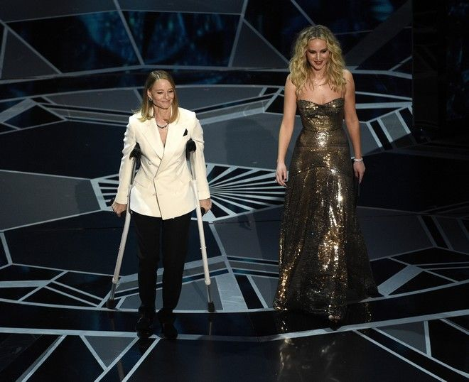 Jodie Foster, left, and Jennifer Lawrence present the award for best performance by an actress in a leading role at the Oscars on Sunday, March 4, 2018, at the Dolby Theatre in Los Angeles. (Photo by Chris Pizzello/Invision/AP)