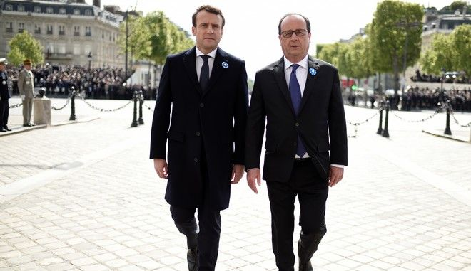 French President-elect Emmanuel Macron, left, and outgoing President Francois Hollande walk side by side during a ceremony to mark the end of World War II at the Arc de Triomphe in Paris, Monday, May 8, 2017. France's youngest president faces the daunting task of reuniting a troubled and divided nation riven by anxieties about terrorism and chronic unemployment and ravaged by a bitter campaign against defeated populist Marine Le Pen. (Stephane de Sakutin, Pool via AP)