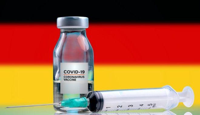 Το εμβόλιο της Pfzer μπροστά από τη Γερμανική σημαία