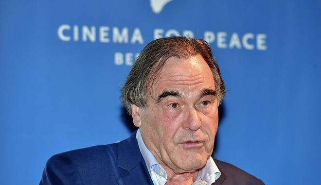 US filmmaker Oliver Stone gives a speech during the award ceremony of the Cinema For Peace at the Bundestag building in Berlin, Monday, Feb. 13, 2017. (John Macdougall/Pool Photo via AP)