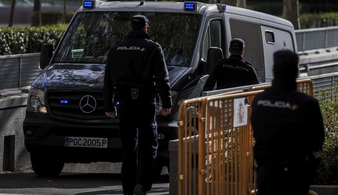A Civil Guard police van arrives to the National Court in Madrid, Friday, Dec. 1, 2017. A Spanish Supreme Court judge is set to decide on Monday if two Catalan pro-independence activists and eight former members of the separatist regional cabinet ousted over a month ago should be released from custody after hearing their appeal. (AP Photo/Gonzalo Arroyo)