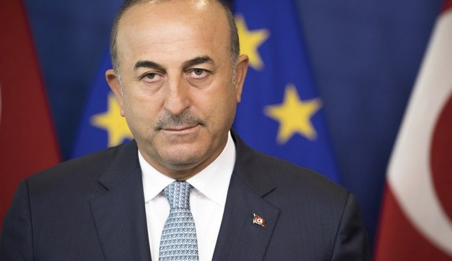 Turkey's Foreign Minister Mevlut Cavusoglu,  attends a press conference with the High Representative of the European Union for Foreign Affairs and Security Policy Federica Mogherini, in Brussels Tuesday July 25, 2017 (AP Photo/Olivier Matthys)