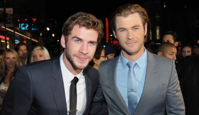 "Liam Hemsworth, left, and Chris Hemsworth arrive at the U.S. premiere of ""Thor: The Dark World"" at the El Capitan Theatre on Monday, Nov. 4, 2013, in Los Angeles. (Photo by John Shearer/Invision/AP)"
