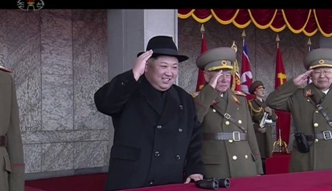 In this image made from video by North Korea's KRT, North Korean leader Kim Jong Un, center, attends a military parade in Pyongyang, North Korea Thursday, Feb. 8, 2018. North Korea held a massive military parade highlighted by intercontinental ballistic missiles in its capital on Thursday, just one day before South Korea hosts the opening ceremony of the Pyeongchang Winter Olympics. (KRT via AP Video)