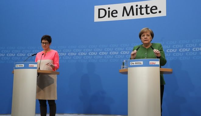 German Chancellor Angela Merkel, right, and the governor of German Saarland state and designated CDU Secretary General, Annegret Kramp-Karrenbauer, left, attend at a news conference after a party's leaders meeting in Berlin, Germany, Monday, Feb. 19, 2018. (AP Photo/Markus Schreiber)