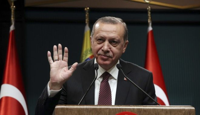 Turkey's President Recep Tayyip Erdogan gestures during a joint media statement with Venezuela's President Nicolas Maduro, following their meeting at the Presidential Palace in Ankara, Turkey, Friday, Oct. 6, 2017. Erdogan said his country does not condone any external interventions in South America after meeting with Maduro, on the first by a Venezuelan head of state official visit to Ankara, than comes amid stringent U.S. sanctions on the South American nation. (Yasin Bulbul/Presidency Press Service, Pool Photo via AP)