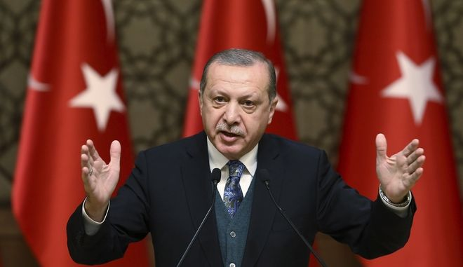 Turkey's President Recep Tayyip Erdogan speaks during a cultural awards ceremony in Ankara, Turkey, Thursday, Dec. 21, 2017. Erdogan has heavily criticized U.S. President Donald Trump for threatening to cut off U.S. funding to countries that oppose his decision to recognize Jerusalem as Israel's capital.  (Kayhan Ozer/Pool Photo via AP)