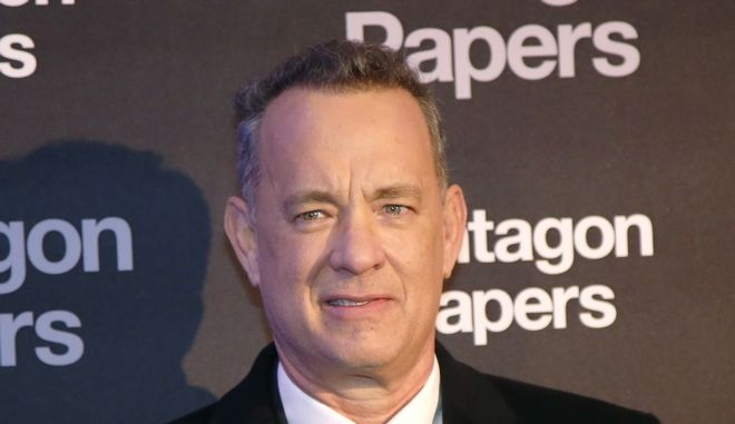 Actor Tom Hanks poses for photographers on arrival at the French premiere of the film 'The Post' in Paris, France, Saturday, Jan. 13, 2018. The title of the French version is 'The Pentagon Papers.' (AP Photo/Michel Euler)