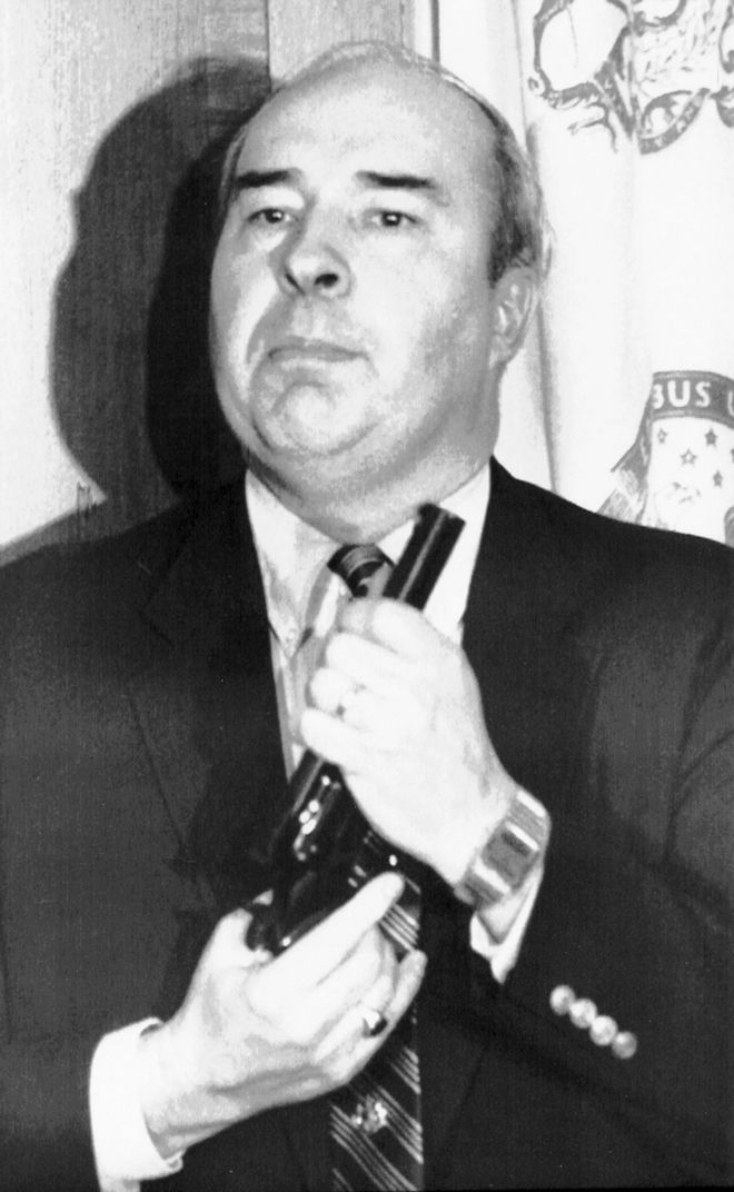HARRISBURG, PA., JAN. 22, 1987 -- Pennsylvania State Treasurer R. Budd Dwyer points a pistol into his mouth as he preperes to pull the trigger killing himself in front of cameras during a news conference in his State Capitol office in Harrisburg. (AP Photo/file)