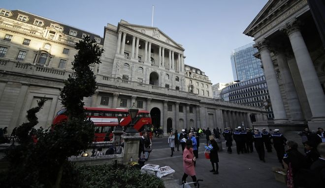 An exterior view shows the facade of the Bank of England in the City of London, Thursday, Nov. 2, 2017. The Bank of England is poised to raise its main interest rate for the first time in a decade to keep a lid on a rise inflation caused by Brexit. The bank is expected Thursday to lift its main rate by a quarter percentage point from the record low of 0.25 percent. (AP Photo/Matt Dunham)