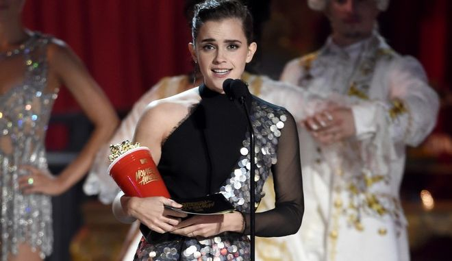 "Emma Watson accepts the award for best actor in a movie for ""Beauty and the Beast"" at the MTV Movie and TV Awards at the Shrine Auditorium on Sunday, May 7, 2017, in Los Angeles. (Photo by Chris Pizzello/Invision/AP)"