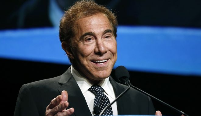 FILE - In this Jan. 15, 2015, file photo, Steve Wynn, CEO of Wynn Resorts, delivers the keynote address at Colliers International Annual Seminar at the Boston Convention Center in Boston. From a pair of giant golden dragons on the edge of a vast man-made lagoon to phoenix and cloud motifs throughout the interior, Wynns new multibillion dollar Macau resort brims with auspicious Chinese symbolism. The U.S. casino mogul will be hoping luck is on his side as he prepares to launch his Wynn Palace project in the Asian gambling hub, where growth is downshifting into a new phase after years of turbocharged expansion. (AP Photo/Elise Amendola, File)