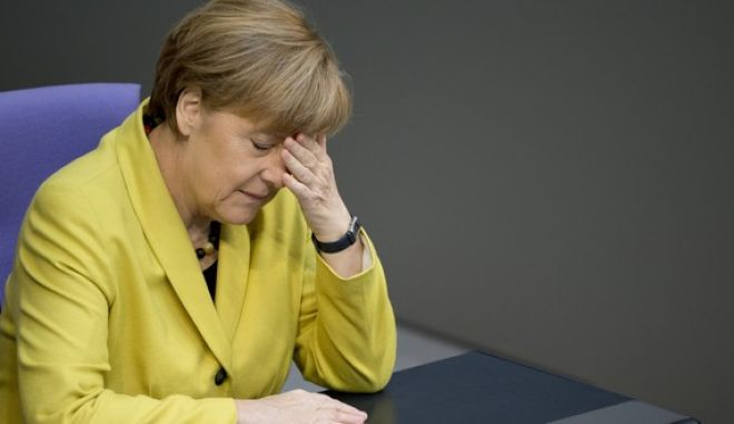 German Chancellor Angela Merkel is seen during a debate at the German parliament, the Bundestag in Berlin on Friday, Feb. 27, 2015. Germany's Parliament overwhelmingly approved the four-month extension of Greece's financial bailout on Friday, despite unease over the new government in Athens.  Lawmakers voted 542-32 to back the bailout extension. There were 13 abstentions.   (AP Photo/Axel Schmidt)